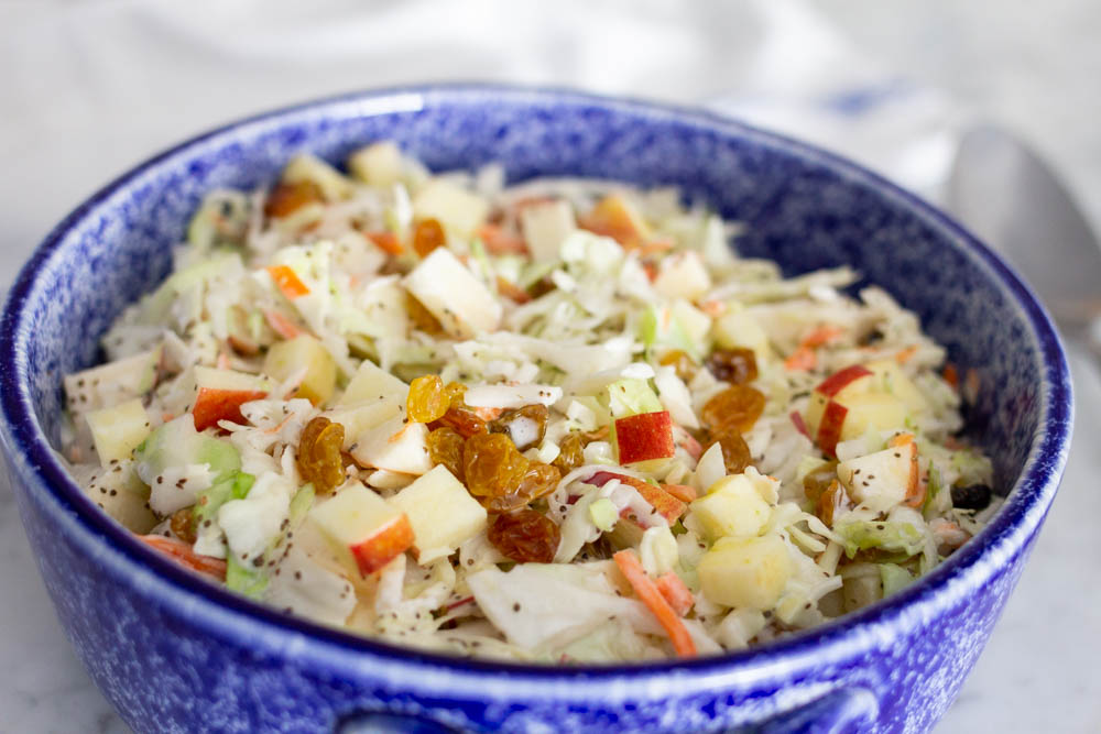 coleslaw made with apples and golden raisins