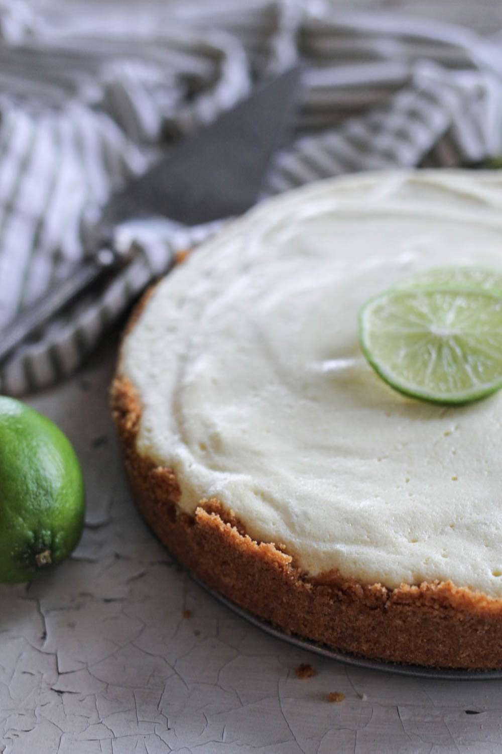 Key Lime pie with towel and fresh limes