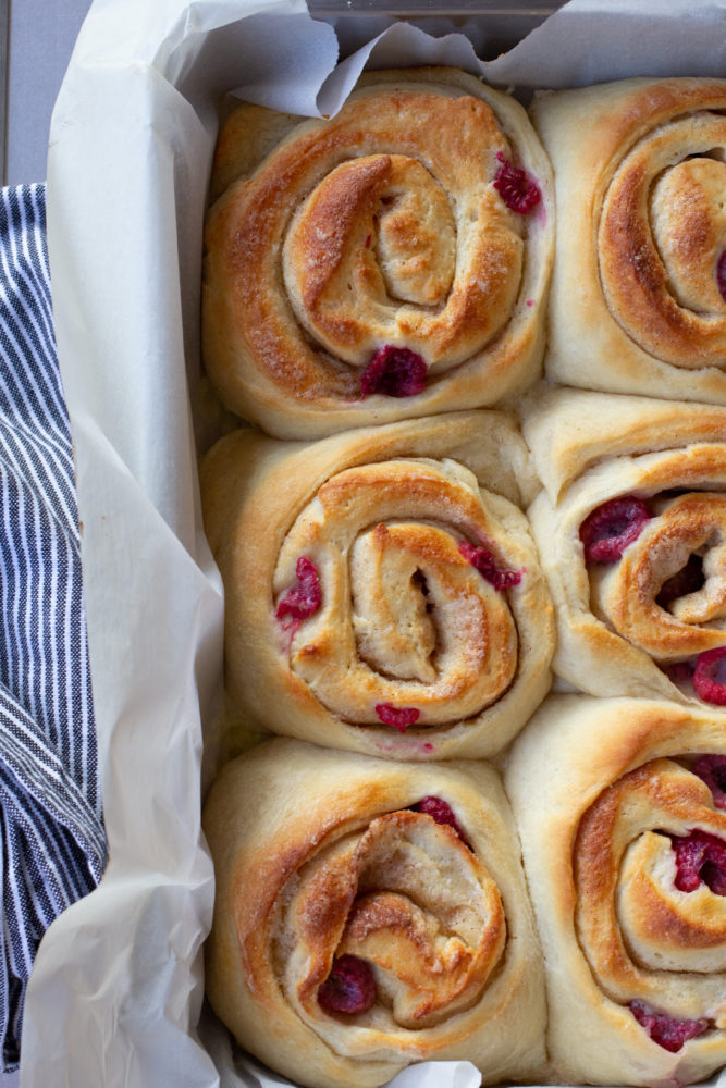 unfrosted cinnamon rolls with fresh raspberry filling