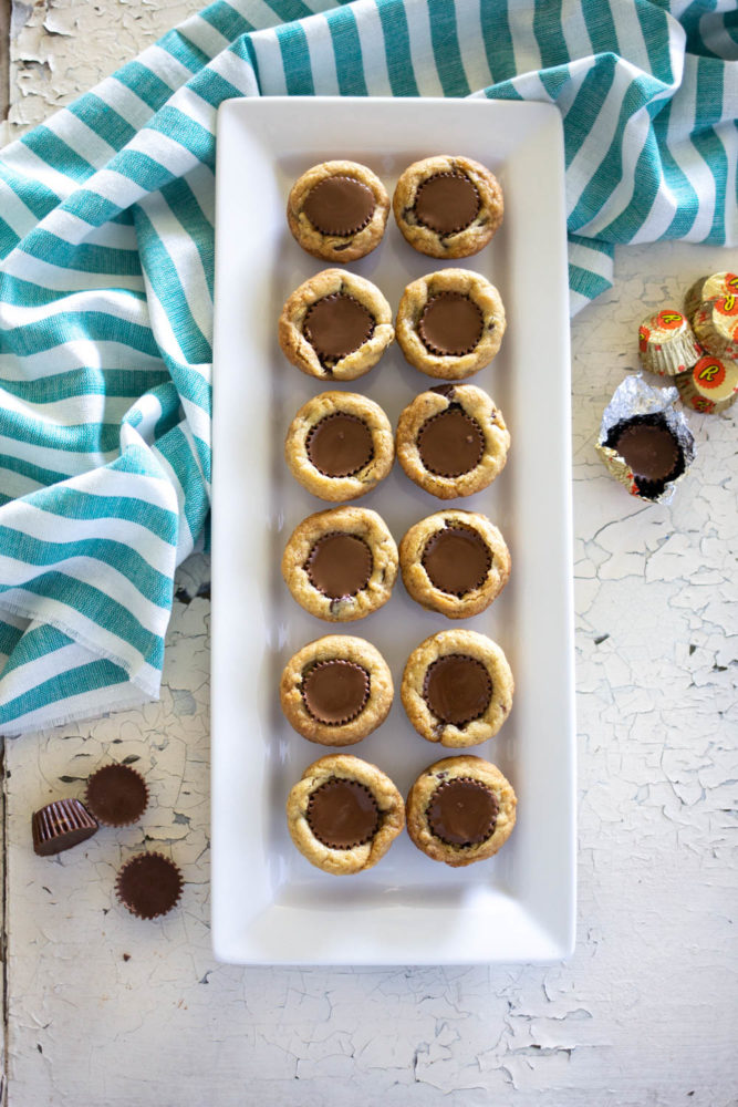 peanut butter and chocolate cookies made with Reeses peanut butter cups