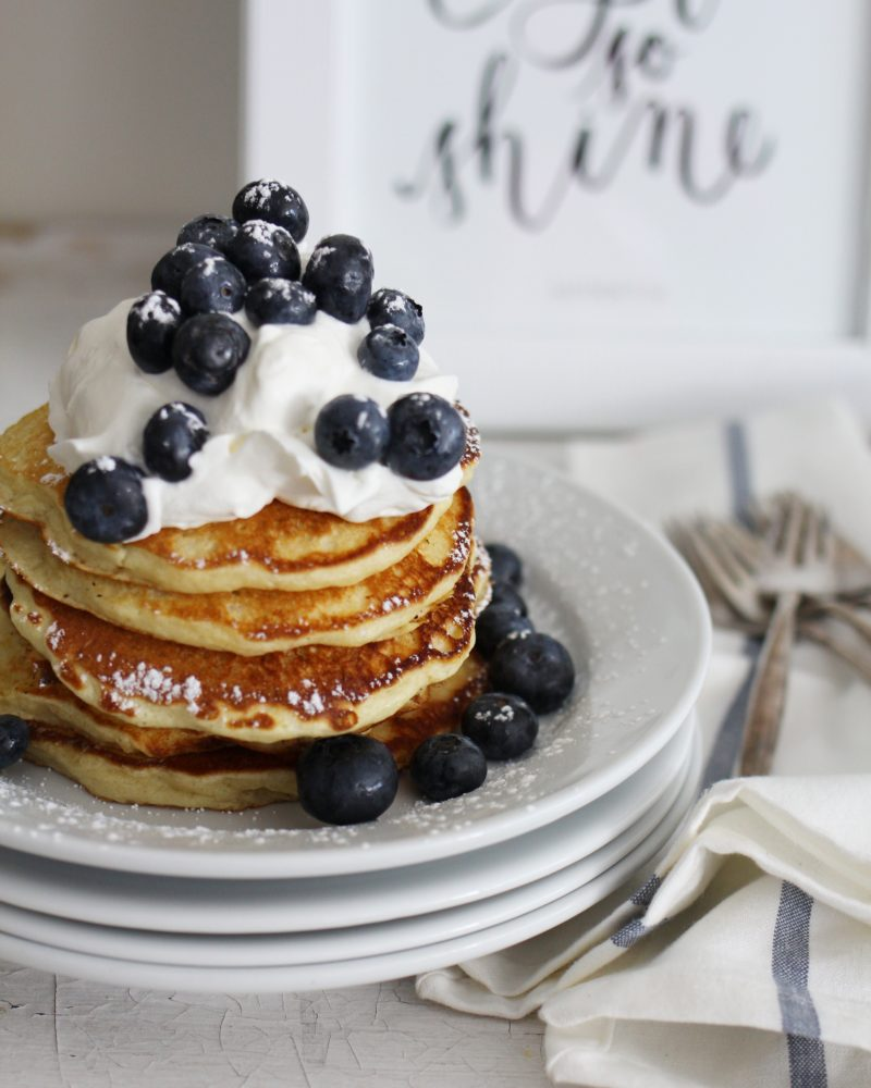 Buttermilk Pancakes with whipped cream and fresh berries