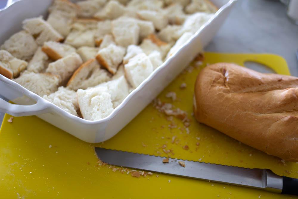Cut up bread for breakfast casserole