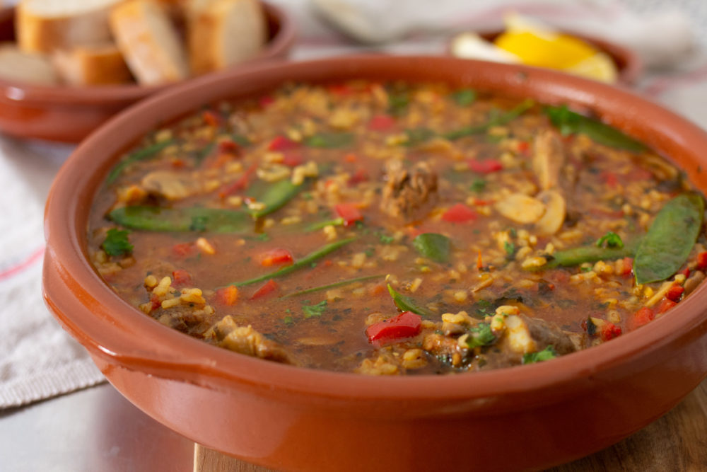 Spanish soup served with bread and lemon