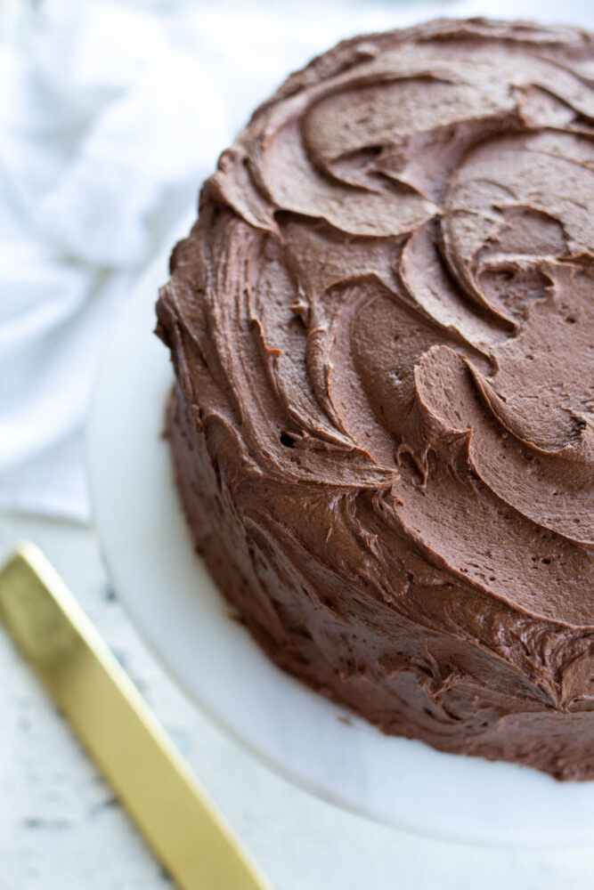 chocolate buttercream frosting on yellow cake