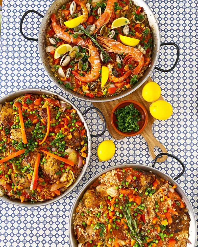 Three different paella: seafood, chicken and rabbit and chicken and chorizo.