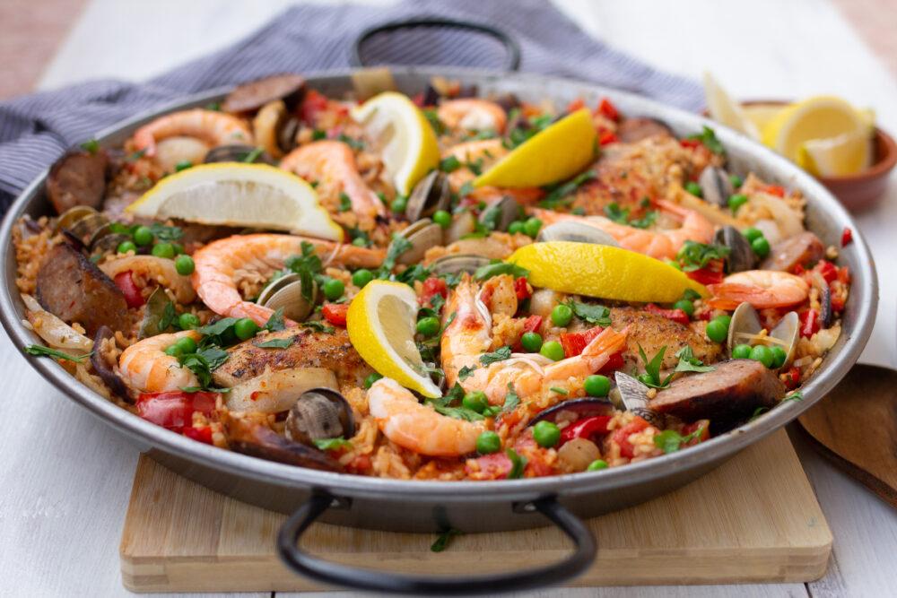 Seafood and chorizo paella with fresh lemon